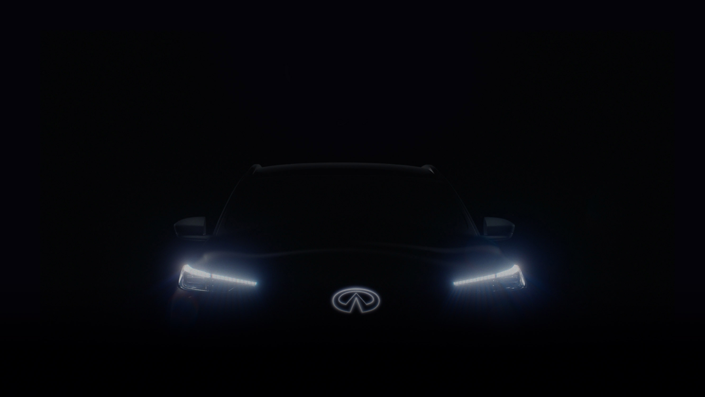 QX60 Monograph in the dark with the headlights and INFINITI badge brightly lit - QX60 Monograph teaser video thumbnail
